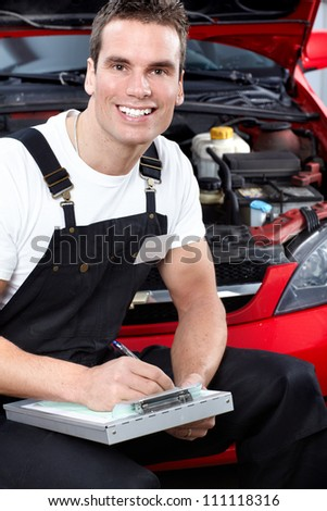 Auto mechanic with tablet. Car repair service. - stock photo