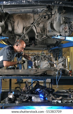 Auto mechanic working under the car - a series of MECHANIC related images. - stock photo