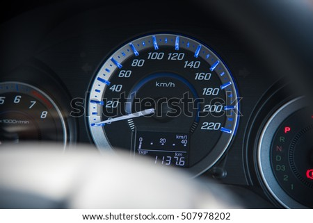 Auto Parts, Car instrument panel dashboard automobile control illuminated panel speed display, close up and shallow depth of field