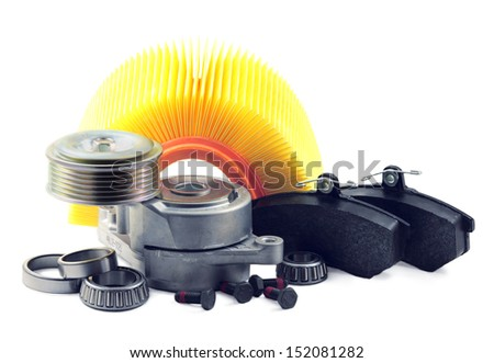 auto parts on a white background. brake pads, filter, bearing.