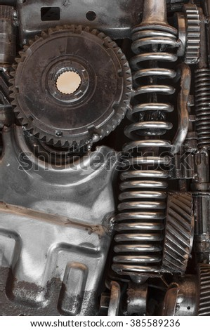 Auto parts with machinery gears and springs  for background.