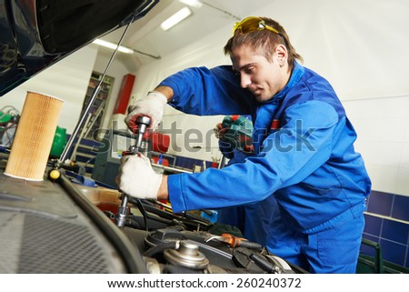 auto repairman industry mechanic worker in car auto repair or maintenance shop service station - stock photo