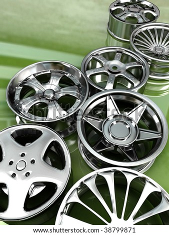 Auto steel alloy car rims over green mirror - stock photo