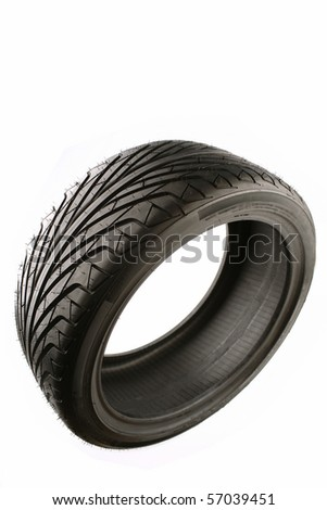 Auto tyre isolated on plain background