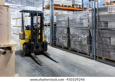 autoloader in a large modern warehouse - stock photo