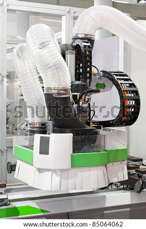 Automated CNC machine for wood in workshop - stock photo