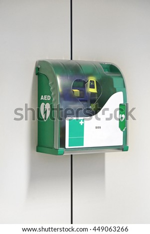 Automated External Defibrillator Emergency Device at Wall - stock photo