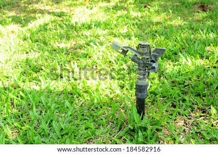 Automated garden lawn sprinkler - stock photo