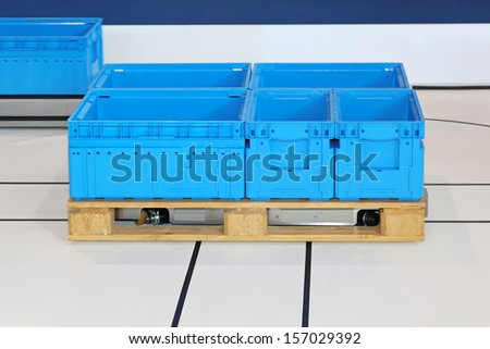 Automated guided pallet with blue boxes