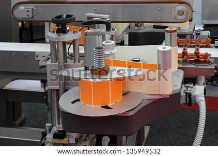 Automated labeling machine equipment with conveyor belt - stock photo