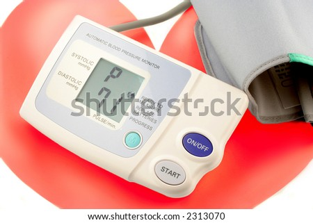 automatic blood pressure monitor showing heart beats per minute