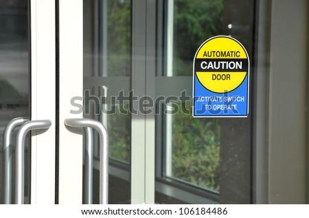 Automatic caution door sign - stock photo