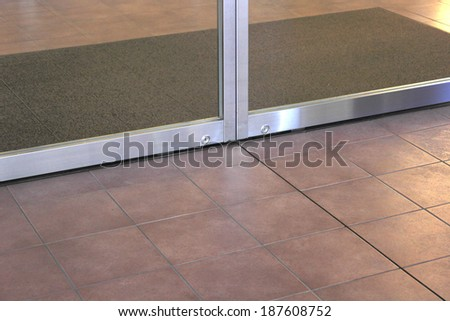 Automatic door of the building entrance - stock photo