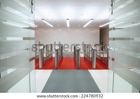 Automatic gates with sliding doors to control the flow of people  - stock photo