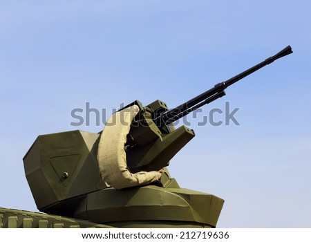 Automatic gun in a rotating turret of the armored vehicle - stock photo