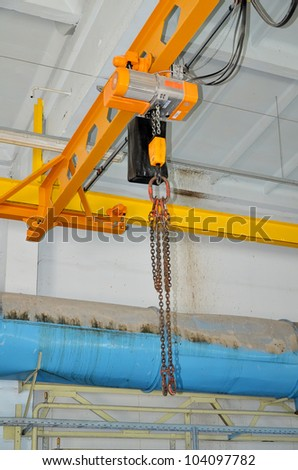 Automatic industrial crane at the plant