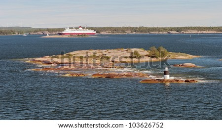 Automatic lighthouse on a small island in the archipelago of the Aland Islands, Finland - stock photo