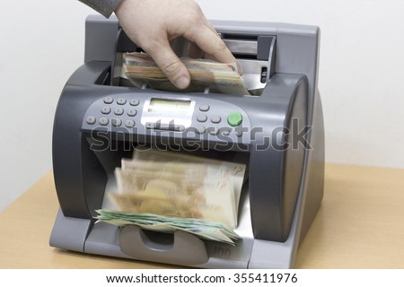 automatic money counting in the machine - stock photo