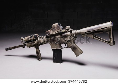 Automatic rifle with  camouflage pattern,laser and optical sights/Army carbine with optical sight - stock photo