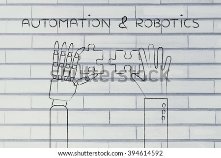 automation & robotics: human and robot hands solving a puzzle - stock photo