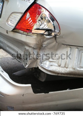 AUTOMOBILE ACCIDENT WITH SMASHED REAR BUMPER - stock photo