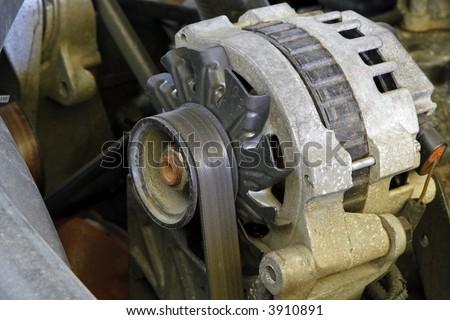Automobile engine electrical system alternator - stock photo