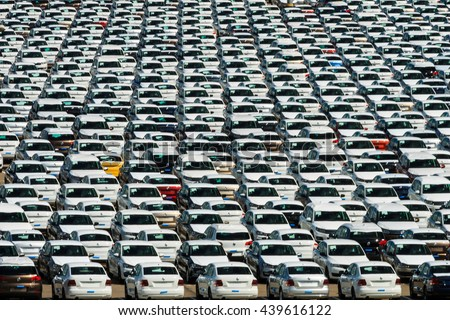 automobile factory, the parking of new car under sky - stock photo