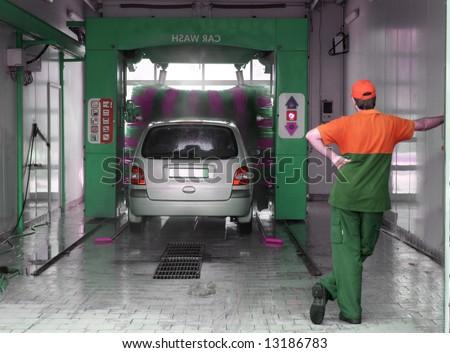 Automobile going through the car wash. - stock photo