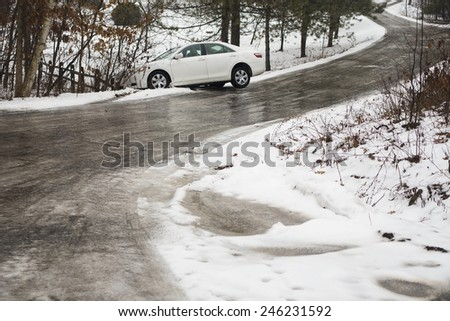 automobile slid off icy winding road - stock photo