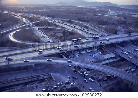 Automobiles trip traffic.Road shot - city cars traffic in Beijing China - stock photo
