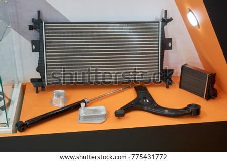Automotive spare parts in the store: radiator, pneamatic tailgate and lever
