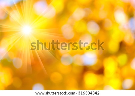Autumn abstract, fall season colors background with a magic sun lights, out of focus - stock photo