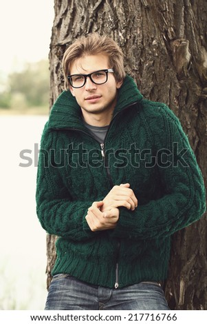 Autumn. Attractive man in the park - stock photo