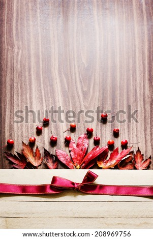 Autumn background/Autumn leaves and berry over wooden background/ Thanksgiving day concept - stock photo