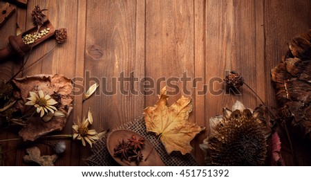 autumn background leaf spices with dried flowers place for inscription