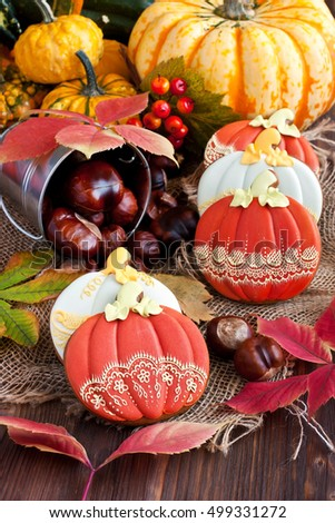 Autumn background with colorful leaves and pumpkin