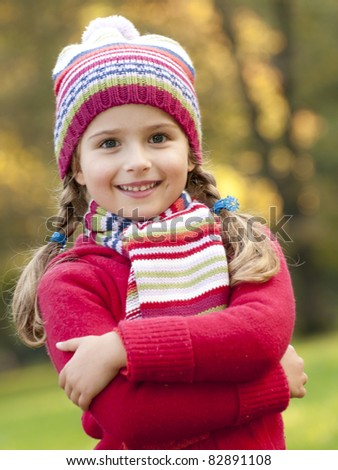 Autumn  - Beautiful girl portrait in autumn park - stock photo