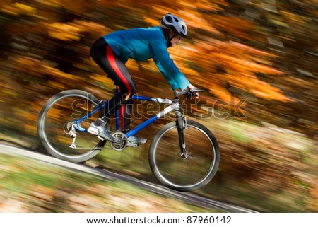 Autumn bike riding - intentional motion blur - stock photo