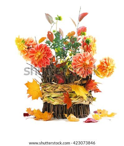 autumn bouquet on basket isolated on white background