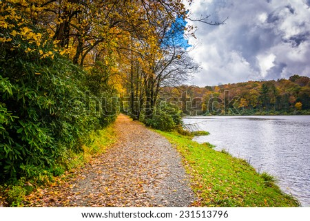Autumn color and trail at the Trout Lake in Moses H. Cone Park, on the Blue Ridge Parkway, North Carolina. - stock photo
