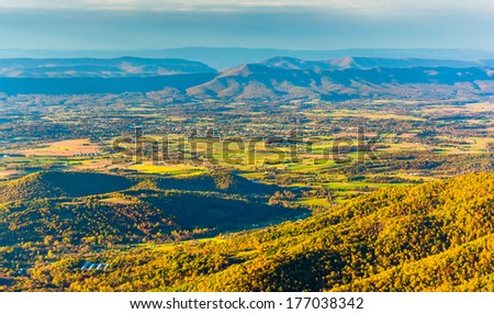 Autumn color in the Shenandoah Valley, seen from Hawksbill Mountain, in Shenandoah National Park, Virginia. - stock photo
