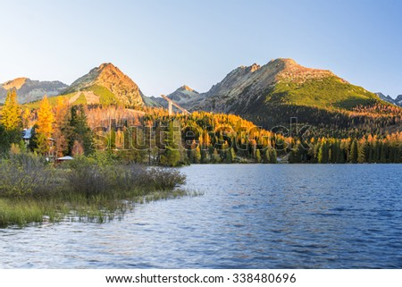 Autumn colored mountain lake on sunrise, Strbske lake, High Tatras, Slovakia