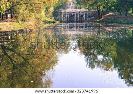 Autumn colors and water reflections in the parks of Moscow, Russia