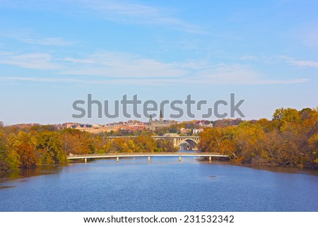 Autumn colors in Georgetown, Washington DC. A view on Georgetown University from Roosevelt Bridge over Potomac River. - stock photo