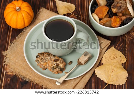 Autumn Concept. Cup Of Tea Or Coffee. Dried Fruits. Cookies With Seeds. Wooden Background.