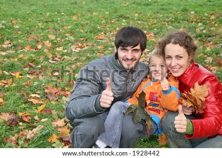 autumn family with finger OK - stock photo