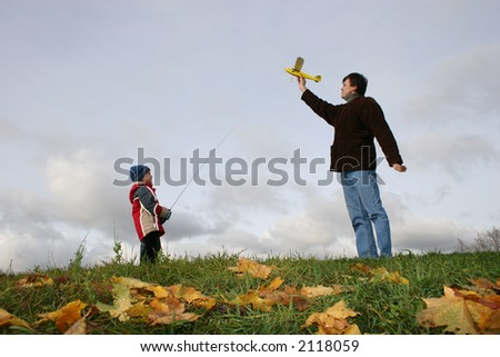 autumn father with son and plane - stock photo