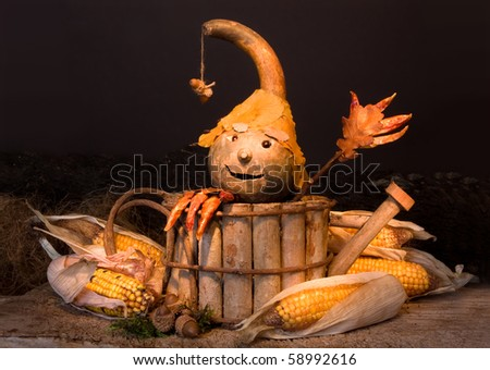 Autumn figurine with gourd head and pepper fingers