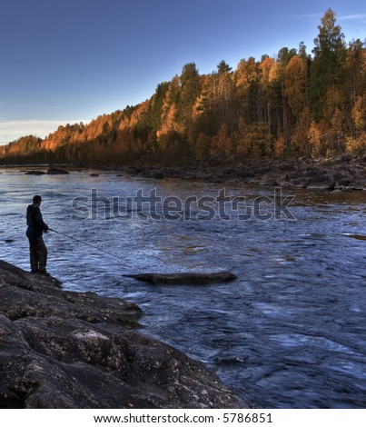 autumn fishing in the north of sweden - stock photo