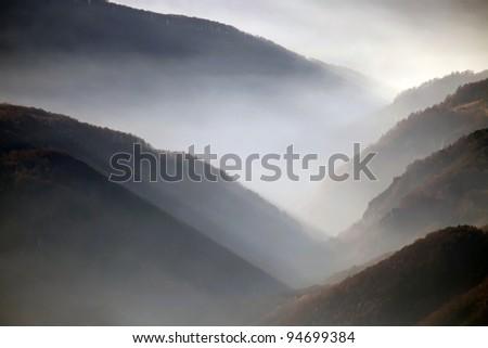 Autumn foggy landscape in Parang Mountains, Romania, Europe - stock photo